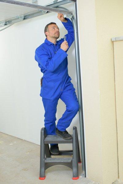 Inspecting Garage Door